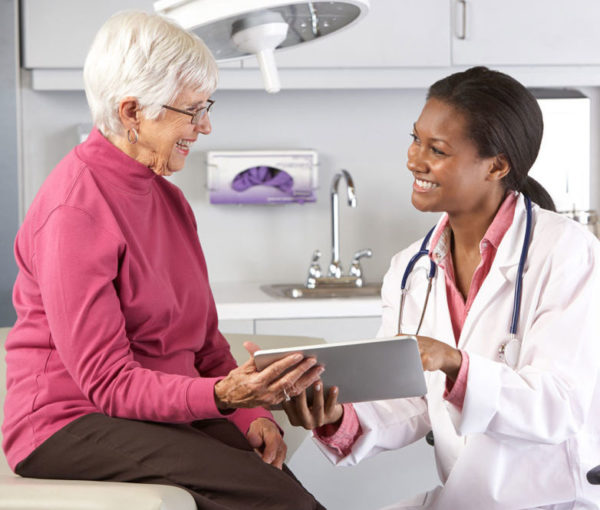 Physician with senior patient
